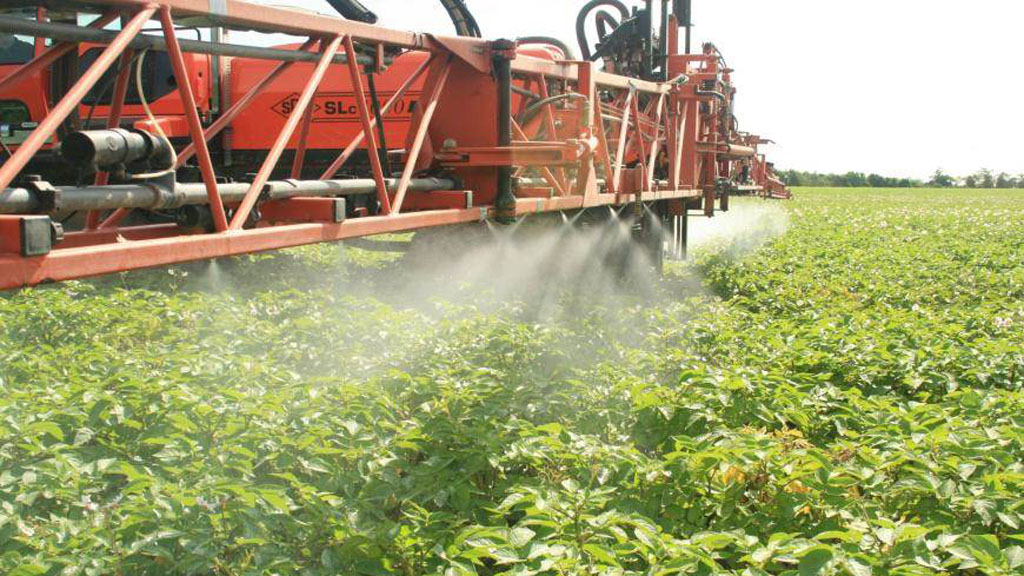 Blight spraying with angled nozzles